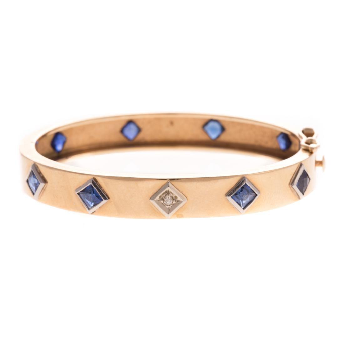 A Lady's 14K Sapphire & Diamond Bangle Bracelet