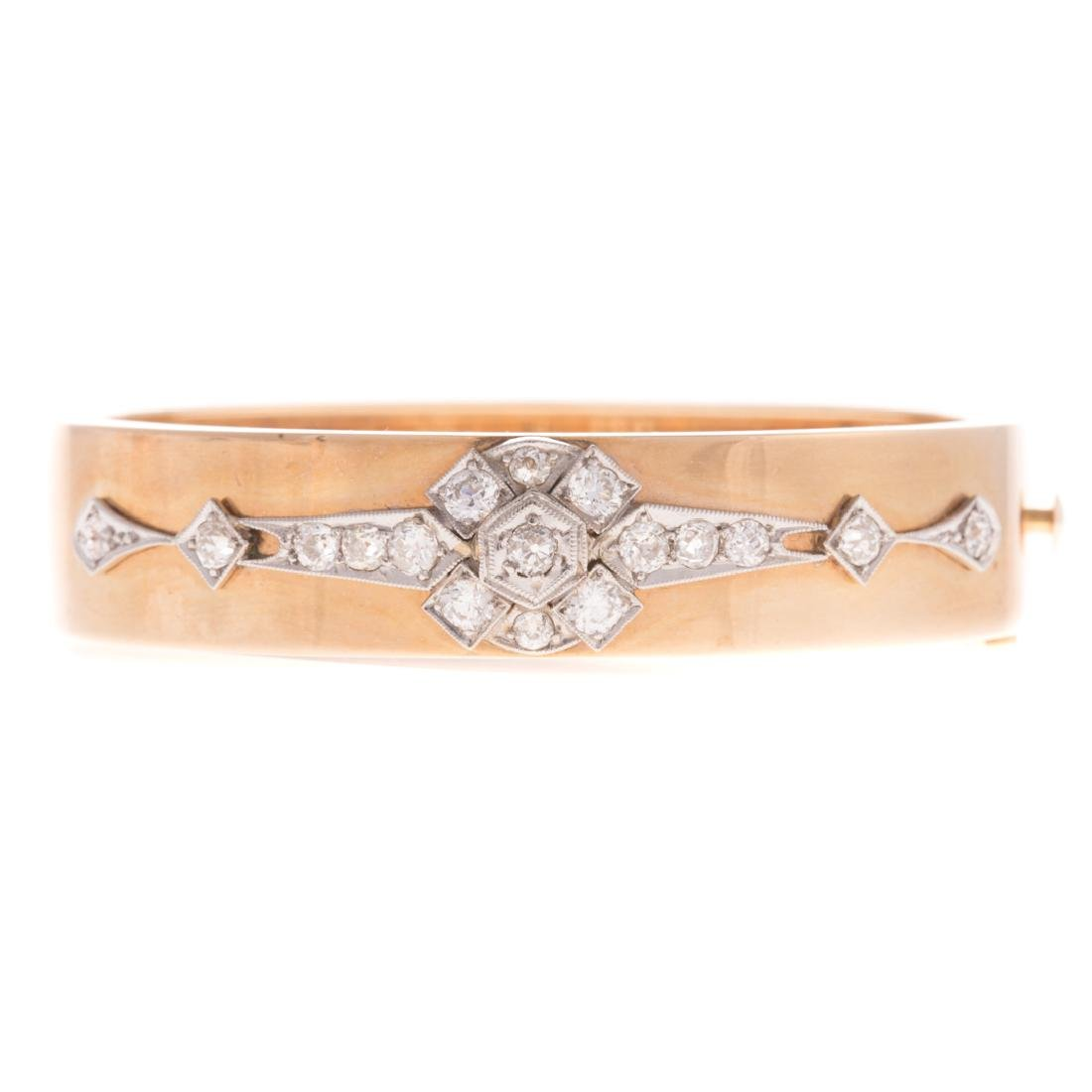 A Lady's 14K Diamond Bangle Bracelet