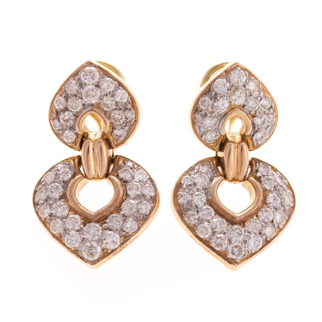 A Lady's 14K Diamond Ear Pendants