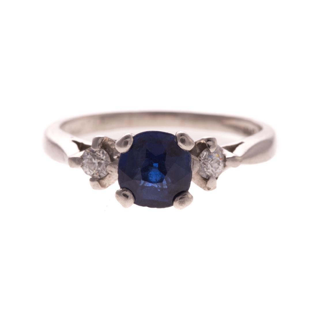 A Lady's Platinum Sapphire and Diamond Ring