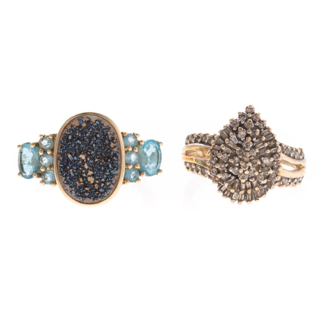 A Pair of Gemstone Rings in Gold