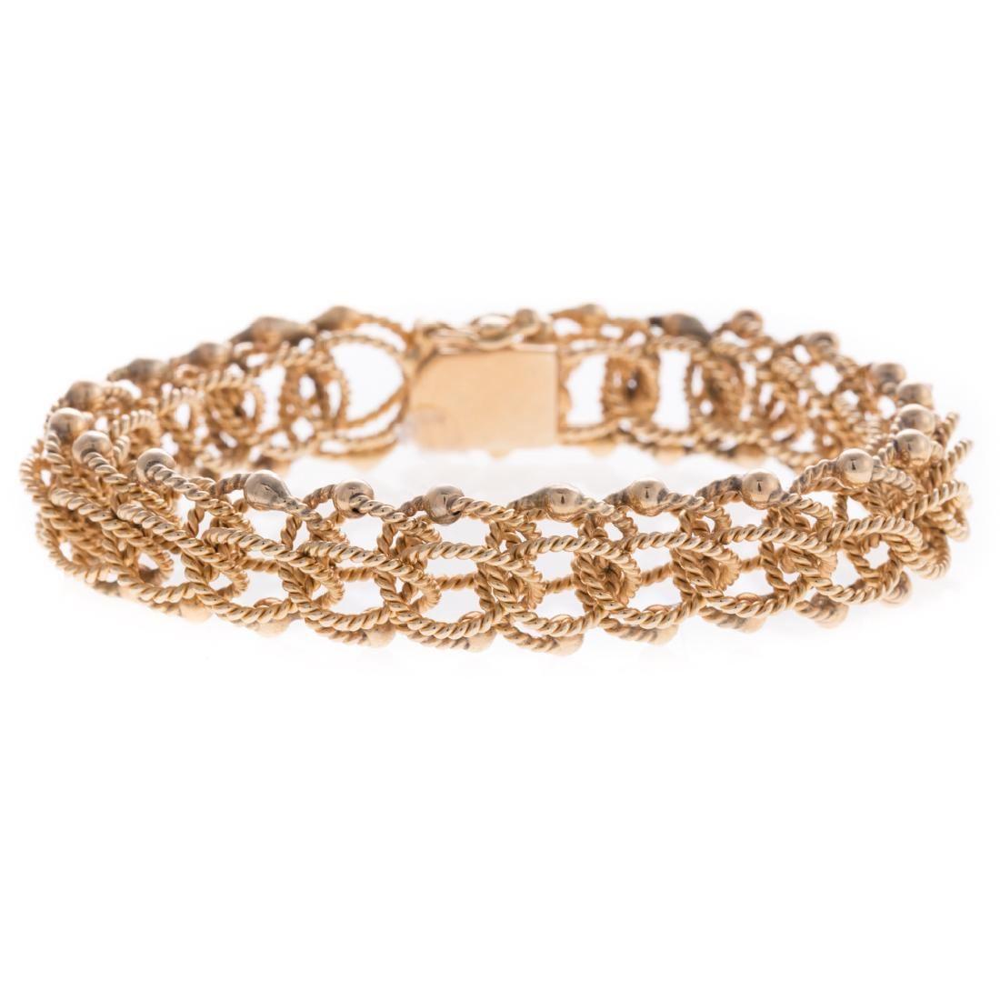 A Lady's Woven Rope Bracelet in 14K Gold