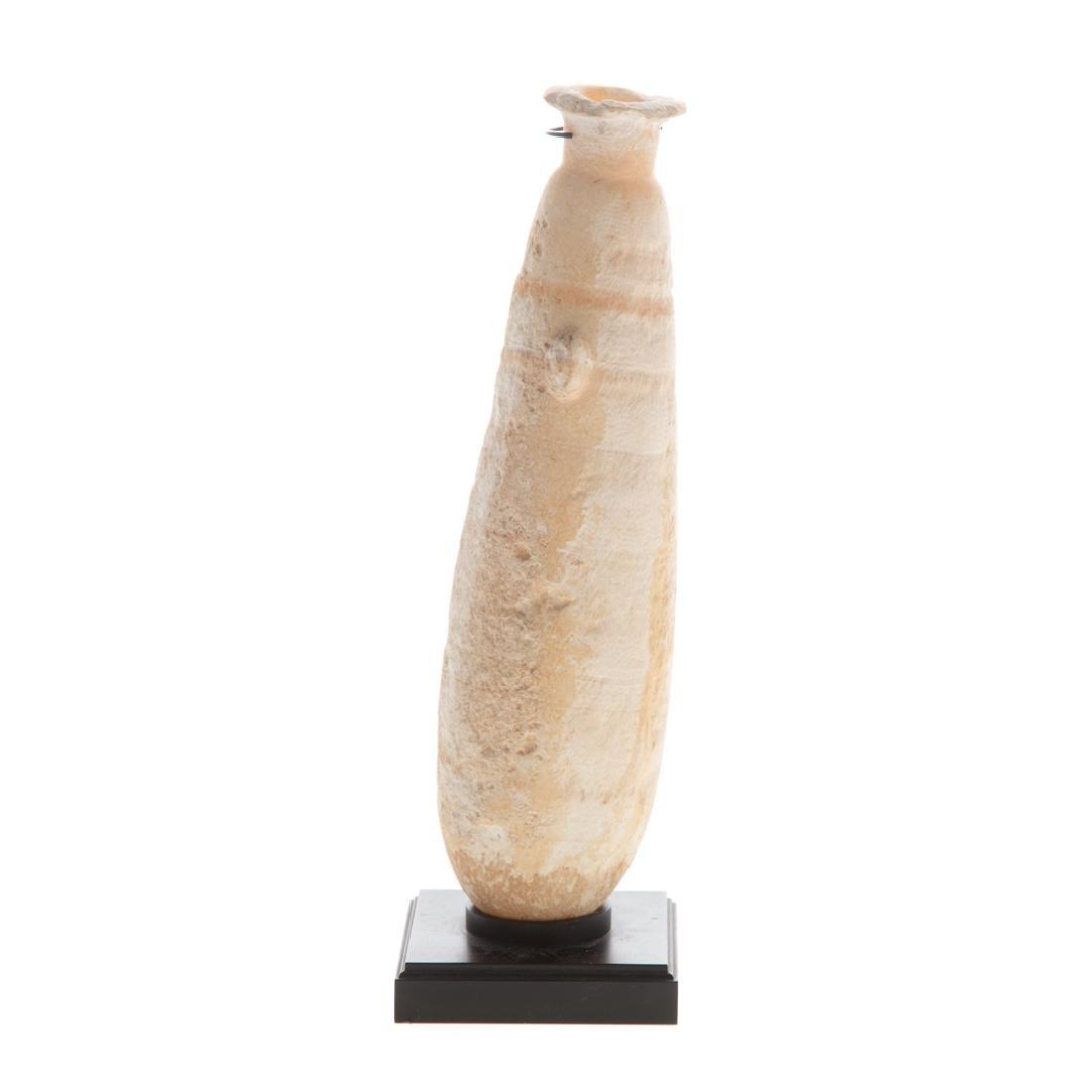 Ancient Egyptian alabaster oil vessel
