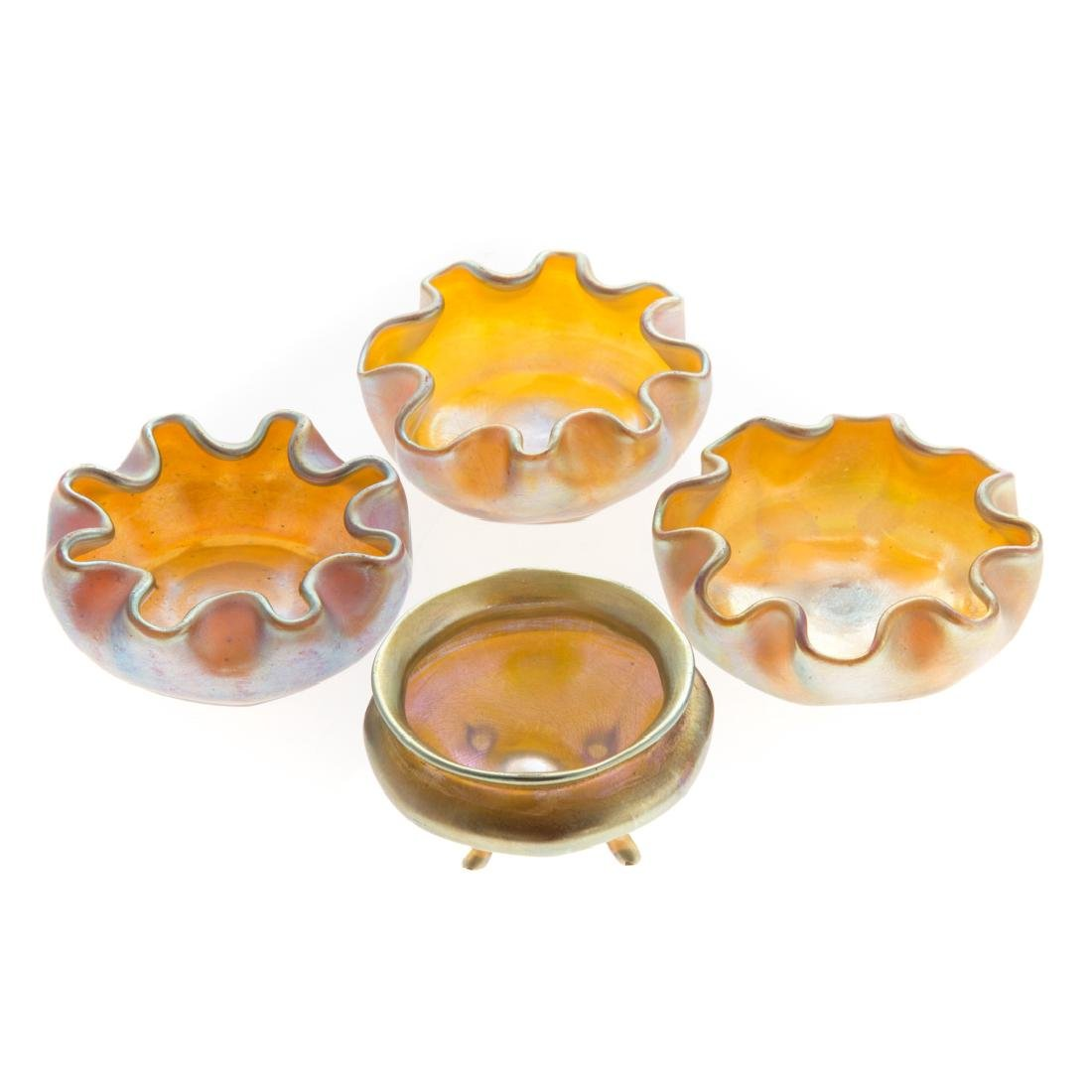Four Tiffany Favrile gold glass salts