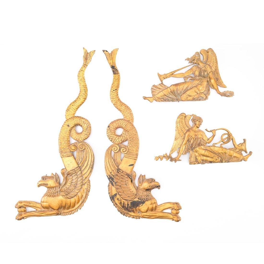 Four French Empire bronze dore mounts