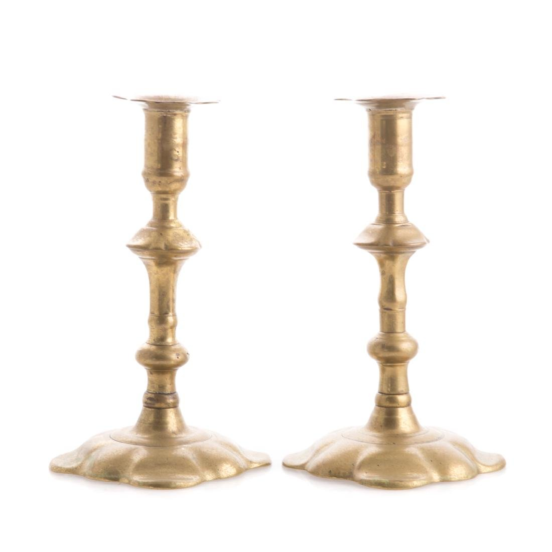 Pair of George II brass petal base candlesticks
