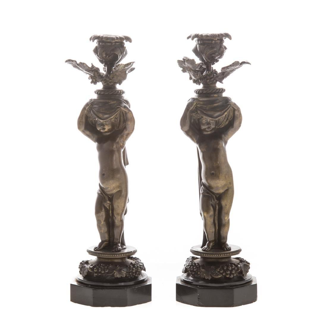 Pair of bronze putti candlesticks