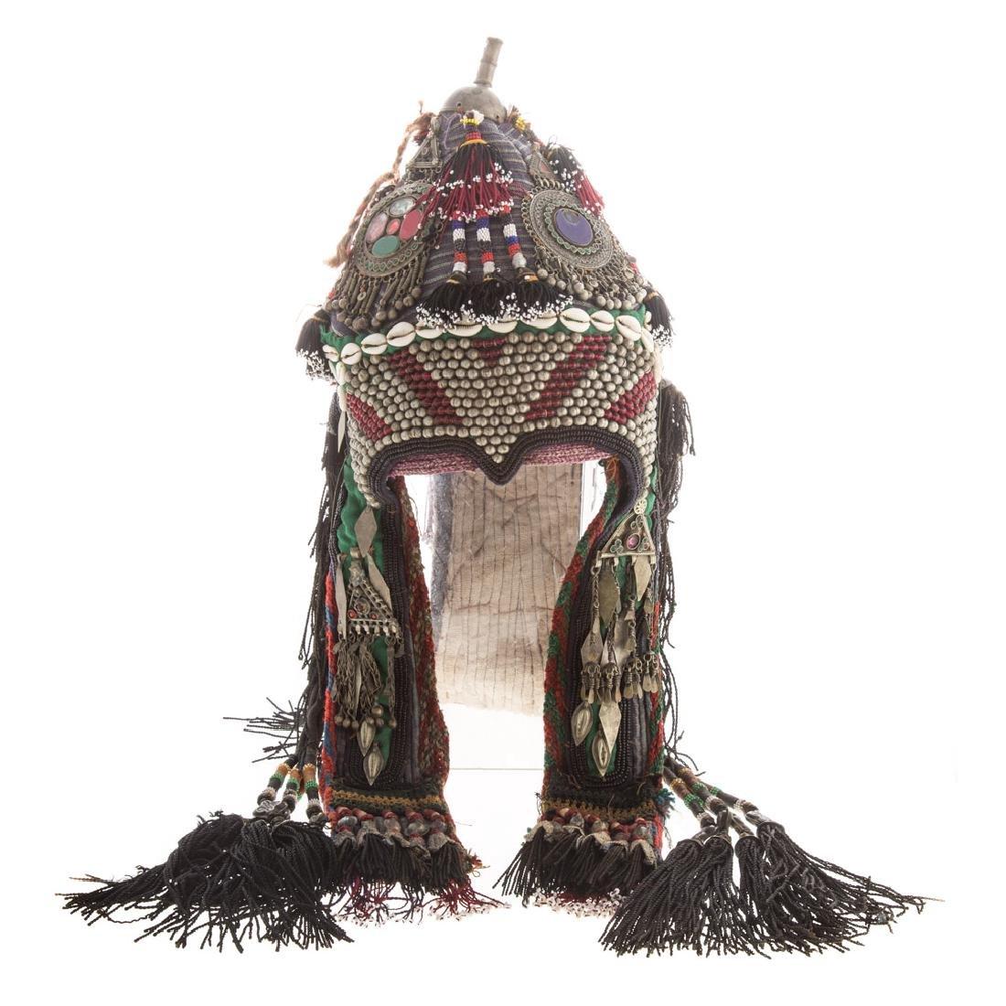 Tribal cloth, bead, and applied object headdress