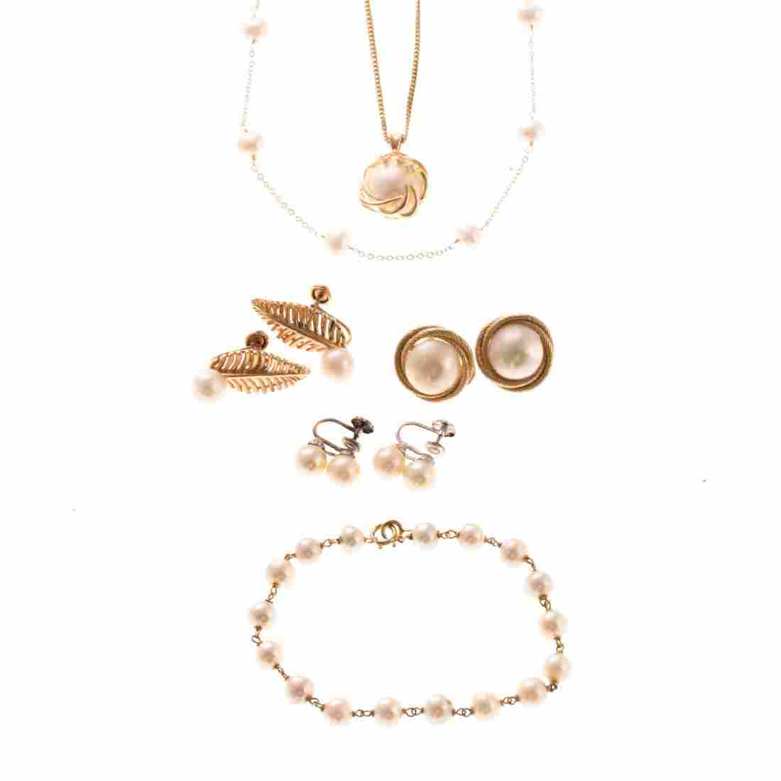 A Collection of Lady's Pearl and Gold Jewelry