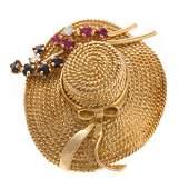 A Lady's 18K Flower Bonnet Brooch