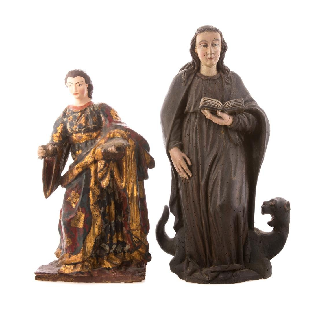 Two carved and painted wood Santos figures