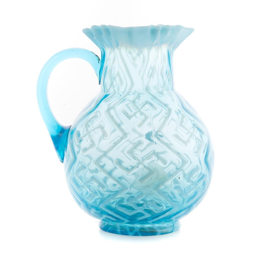 Dugan opalescent blue glass swastika pitcher