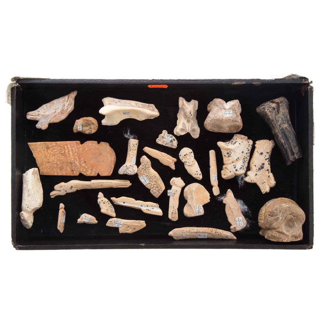 Assortment of ethnographic carved bone objects