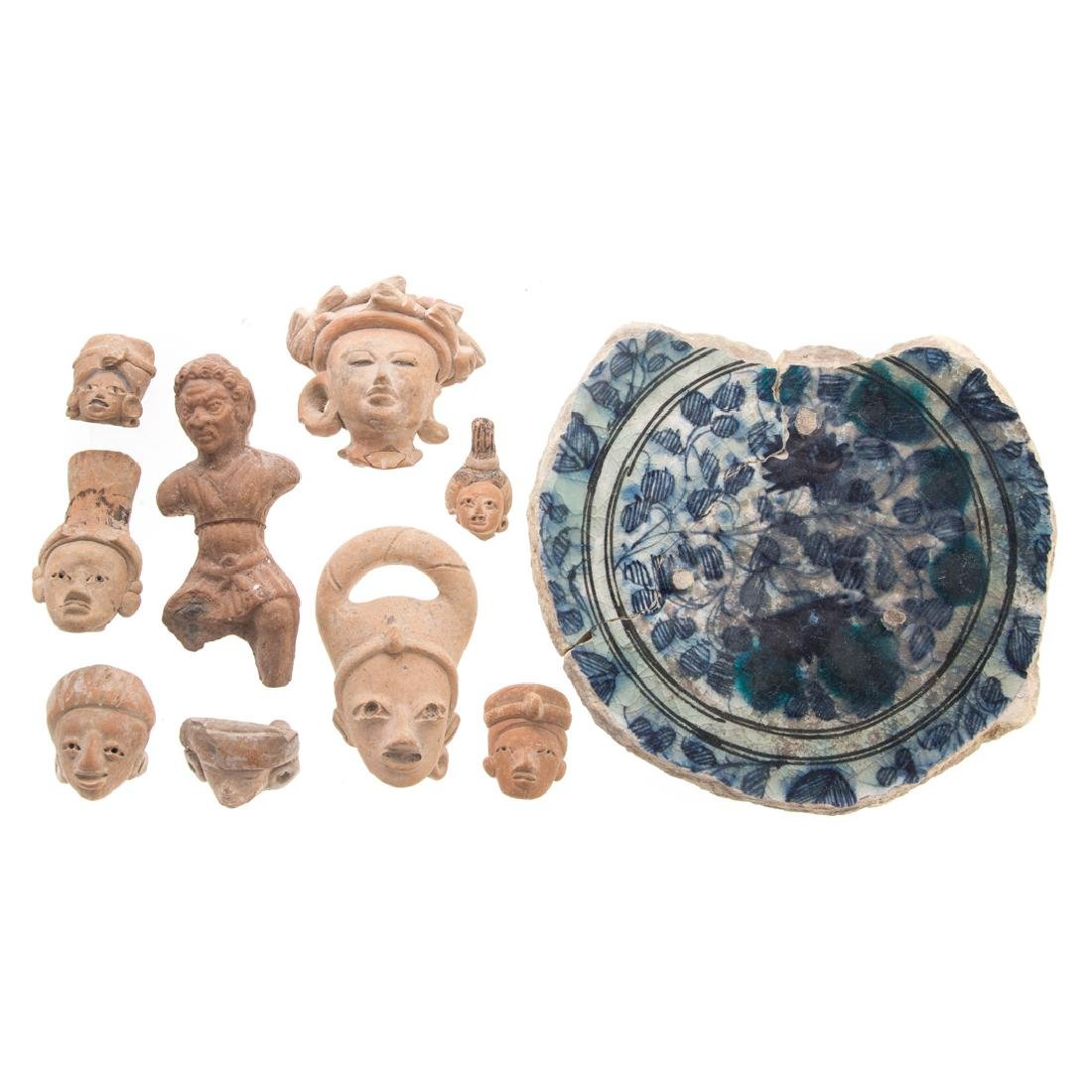 Nine assorted ancient pottery fragment heads
