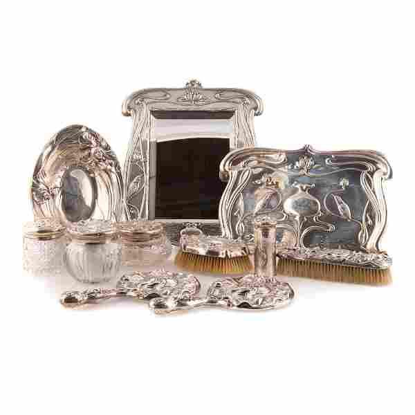 Trio of Art Nouveau sterling vanity sets
