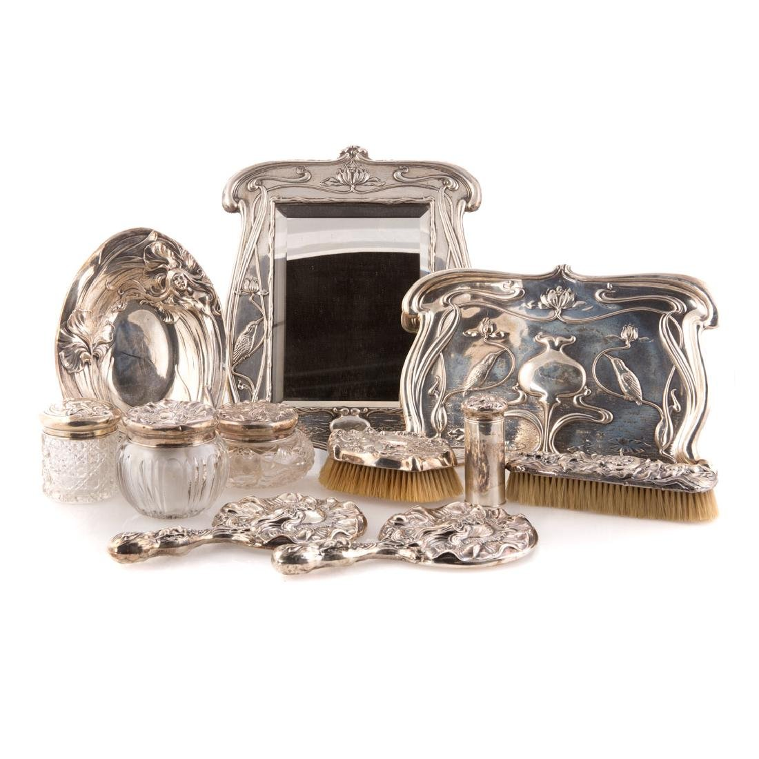 Trio of Art Nouveau sterling vanity sets