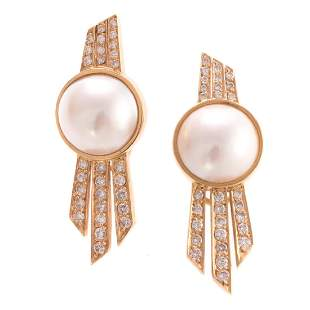 A Pair of Mabe Pearl Diamond Earrings in Gold