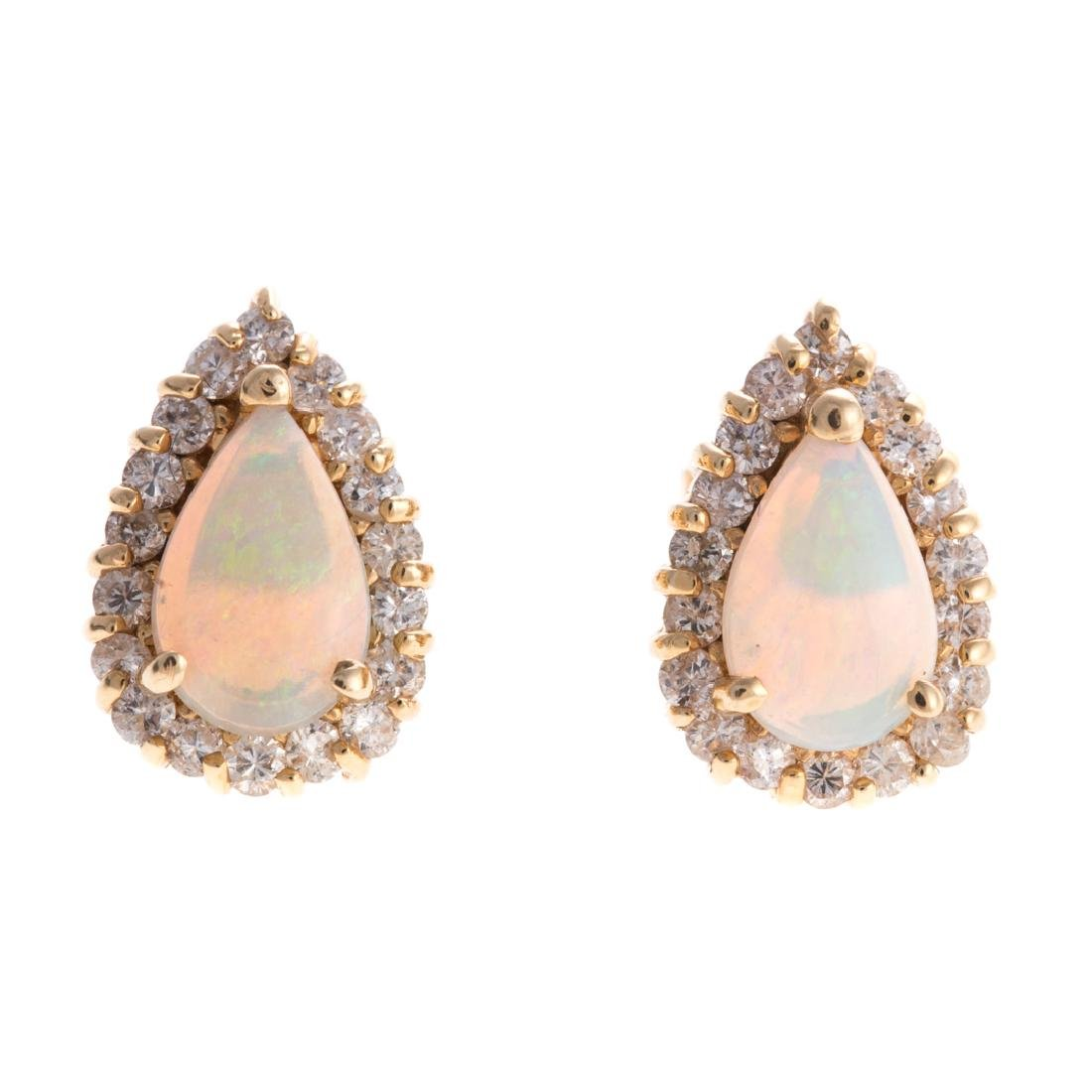 A Pair of Lady's Opal and Diamond Earrings