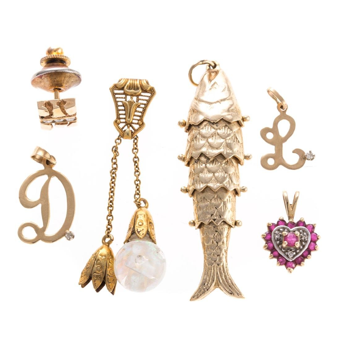 A Collection of Gold Charms & Pendants