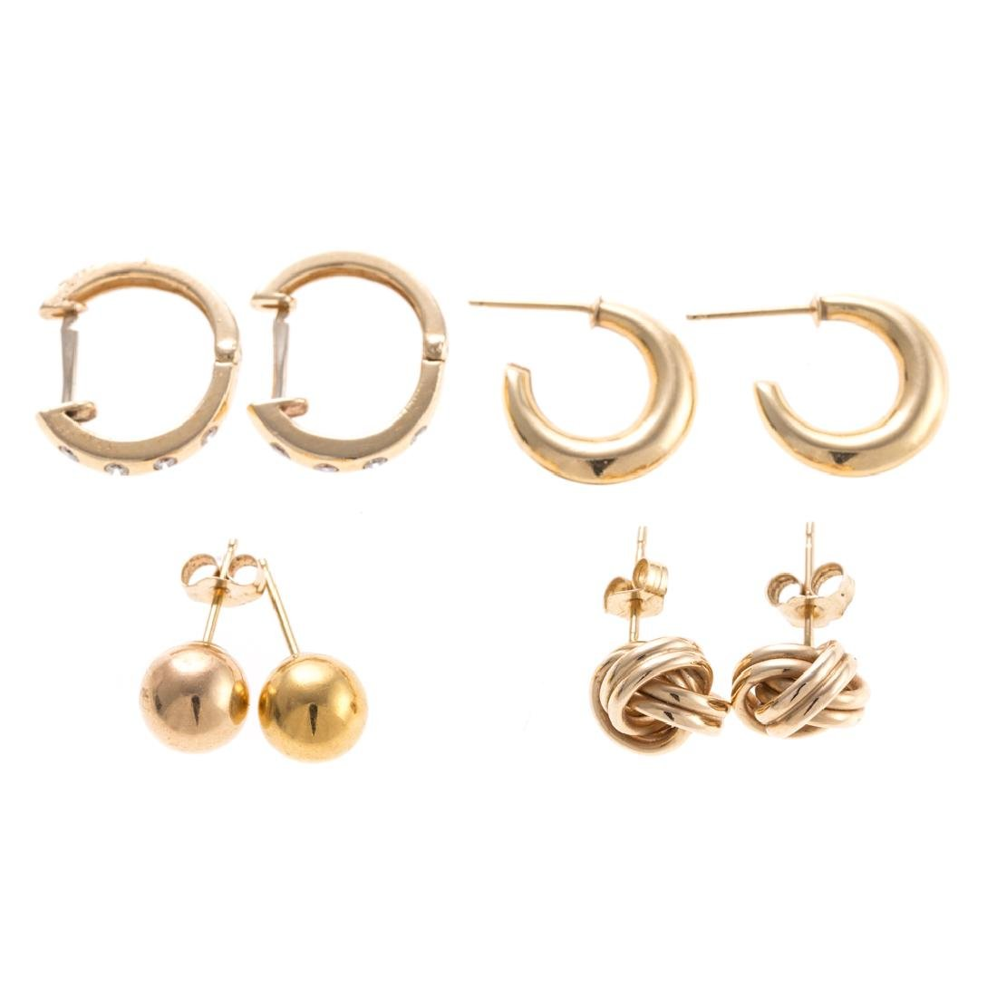 Four Pairs of Classic Hoops and Stud Earrings