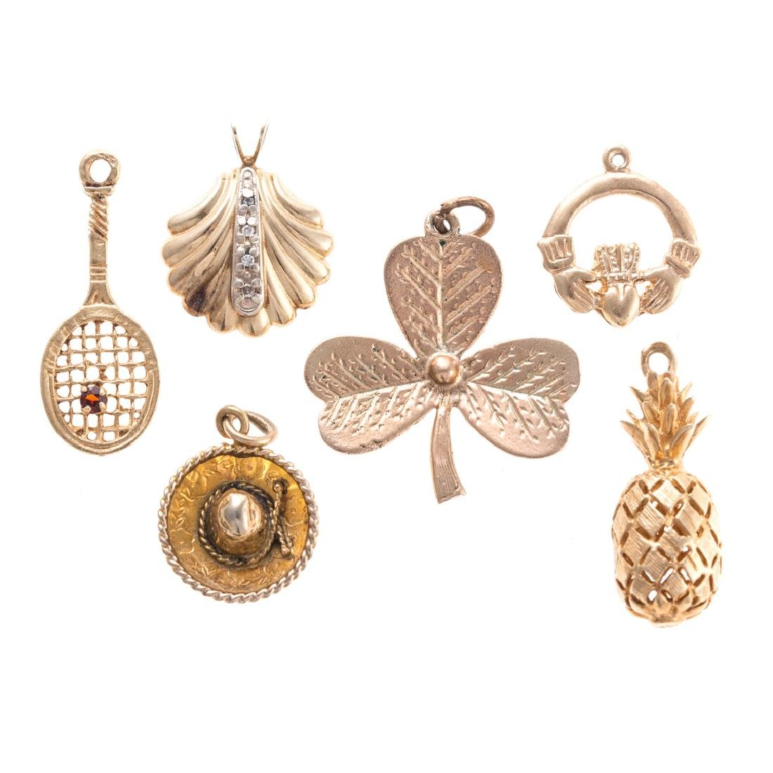 A Collection of Gold Charms
