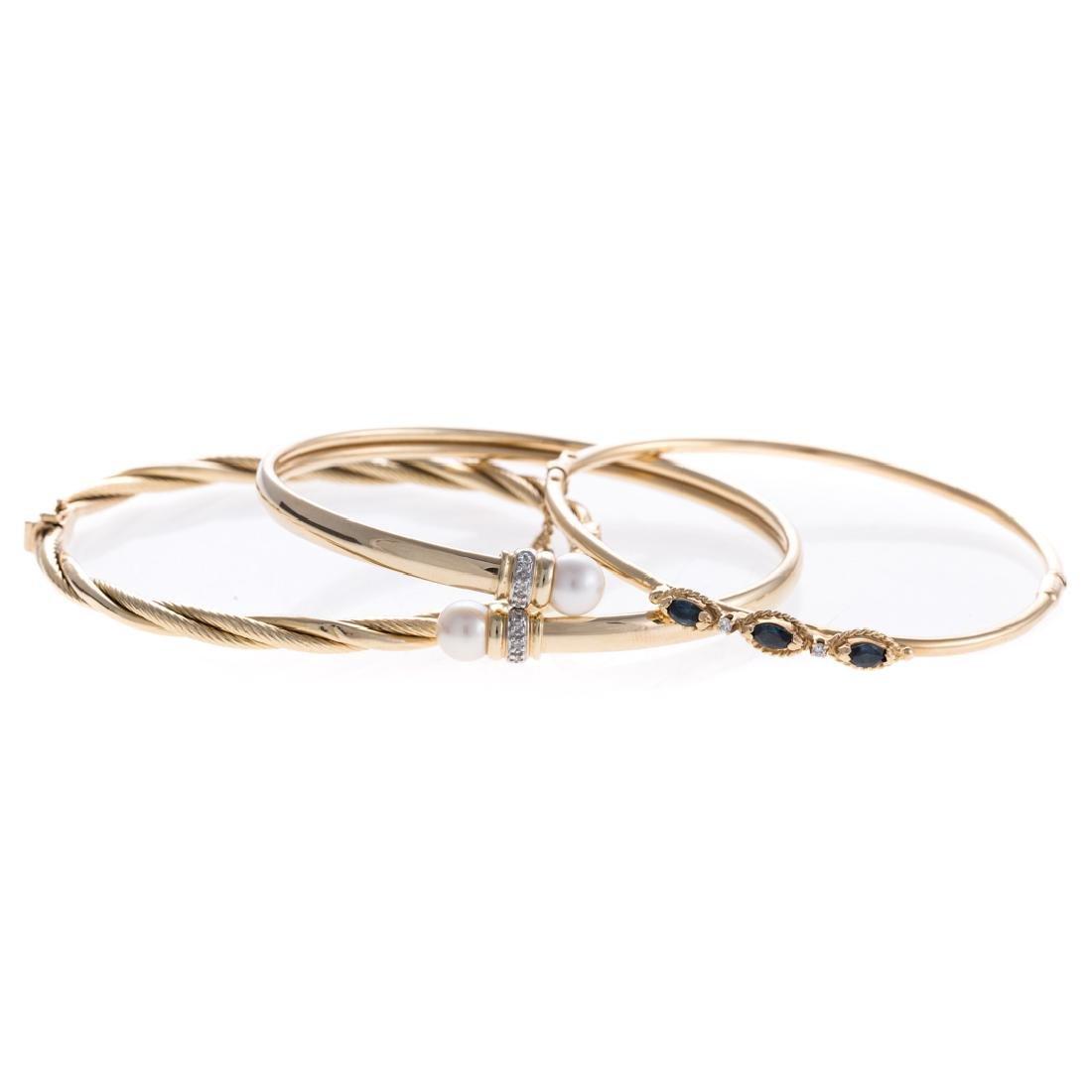 A Trio of Lady's Gold Bangle Bracelets