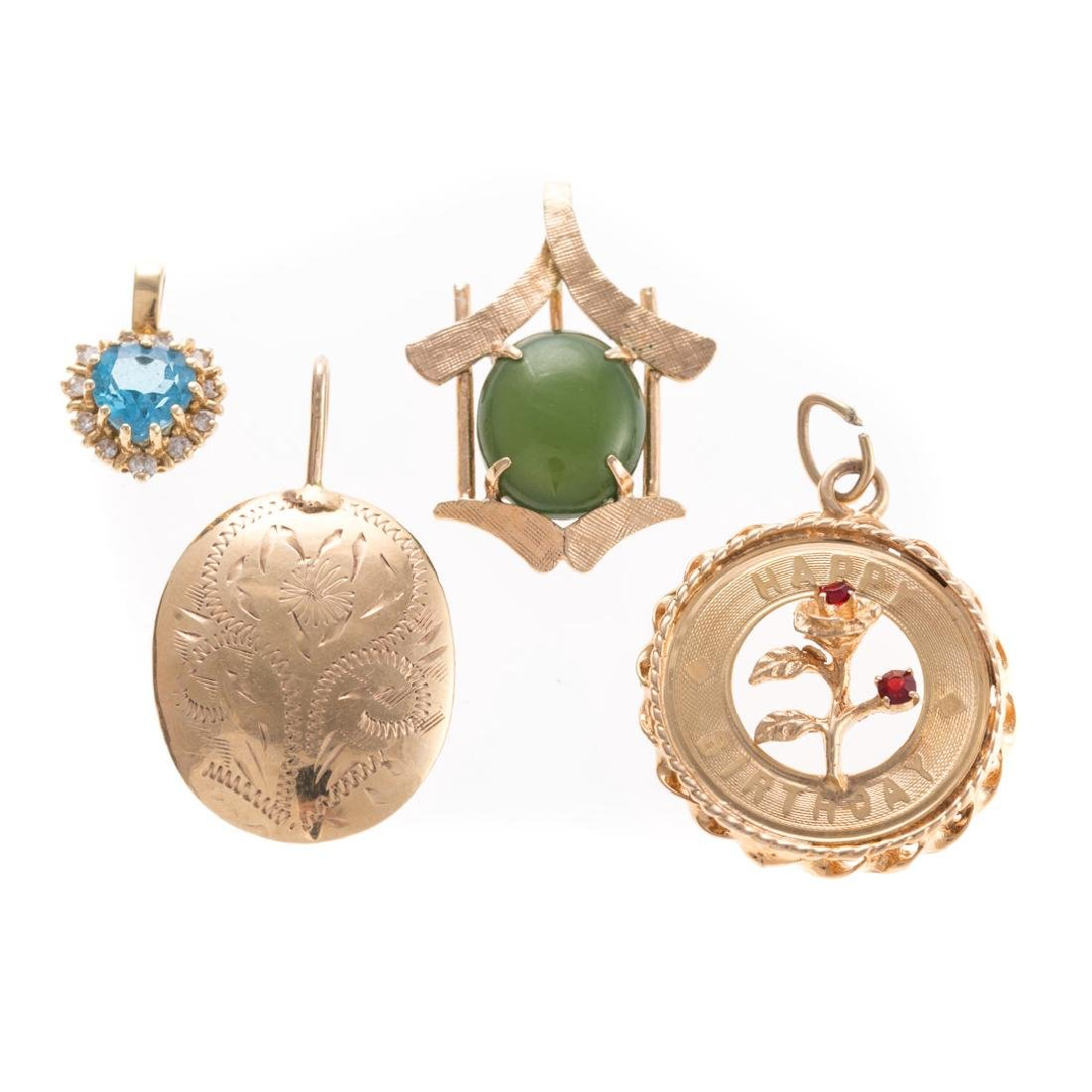 A Set of Four Gold Charms