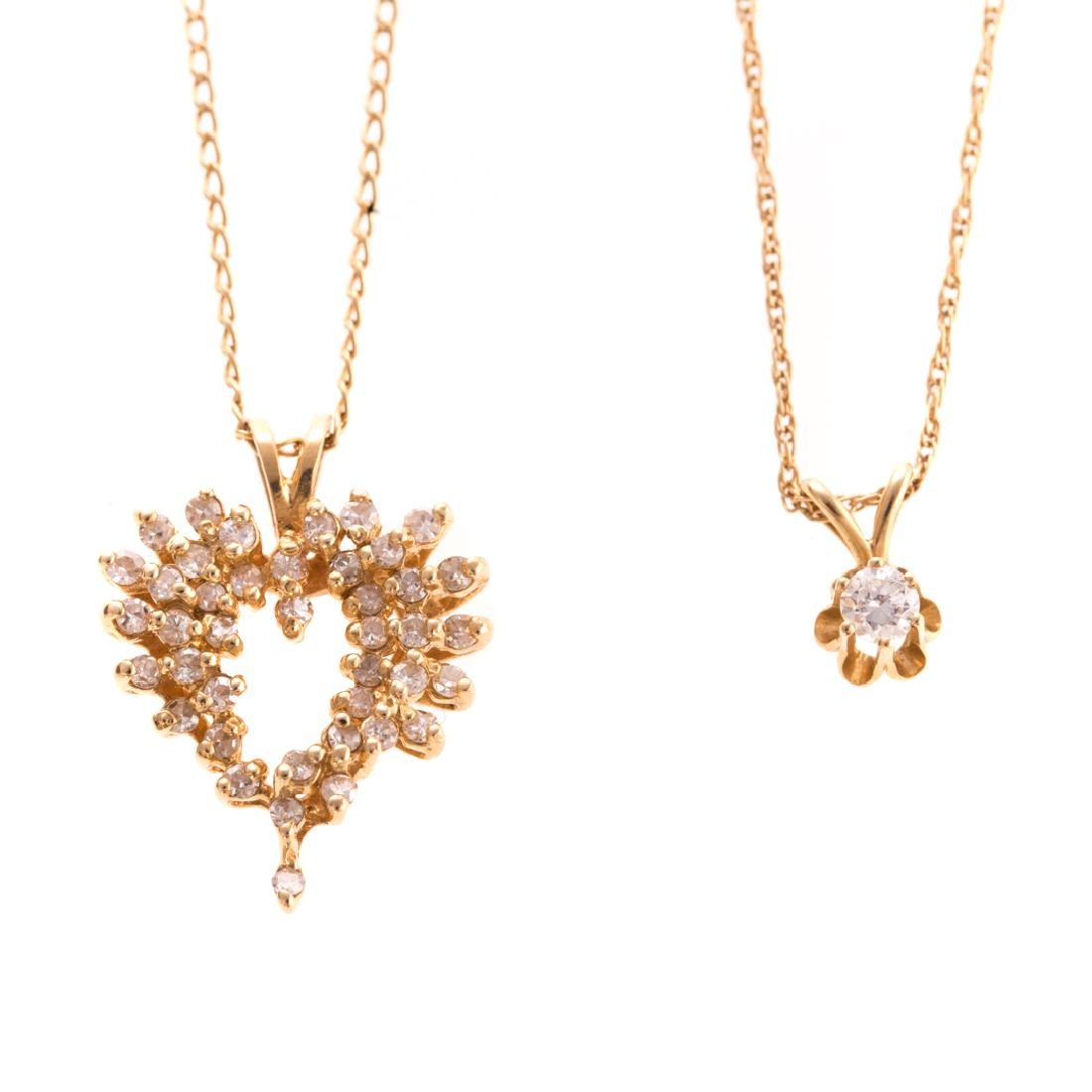 A Pair of 14K Diamond Pendants
