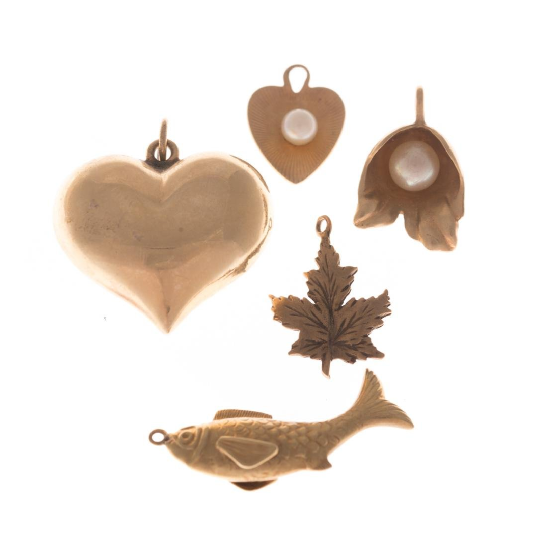 An Assortment of lady's Gold Charms