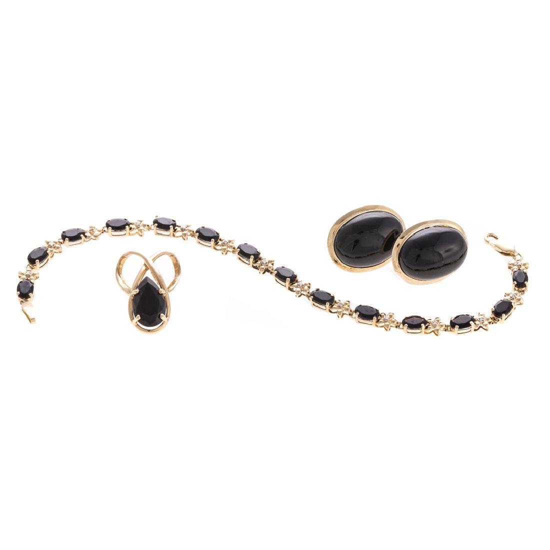 A Suite of Lady's Black Onyx Jewelry in 14K Gold