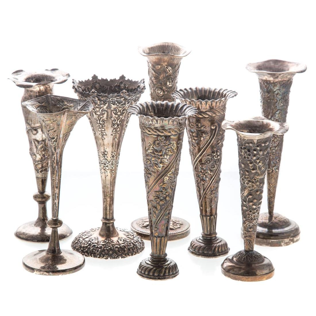 Eight repousse silver bud vases