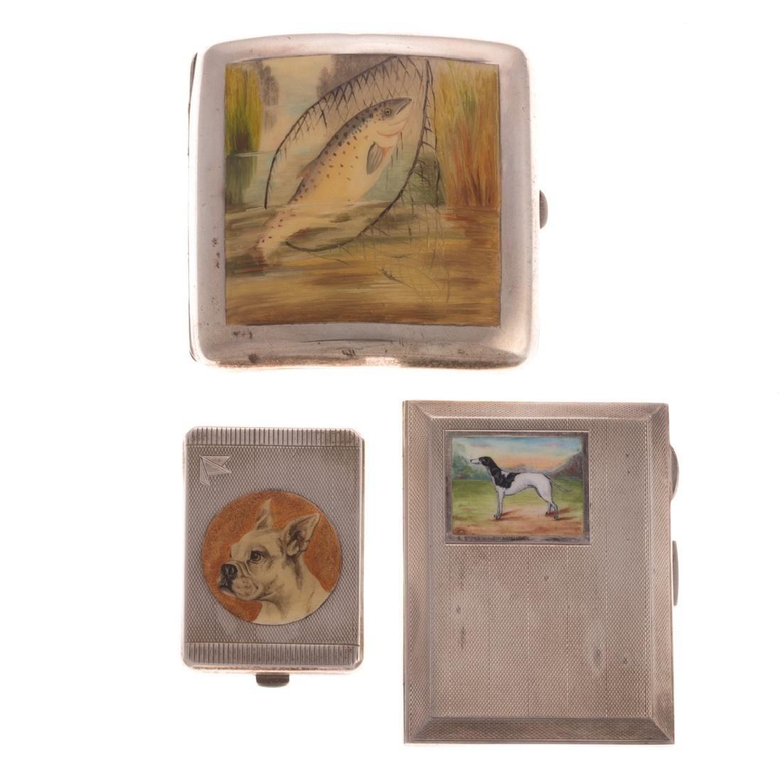 Three George V enameled silver cases