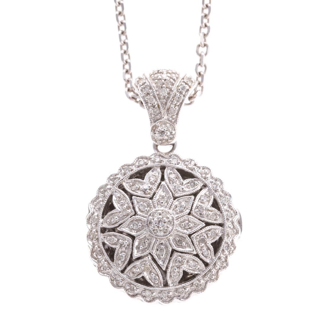 A Lady's 14K Diamond Locket & Chain