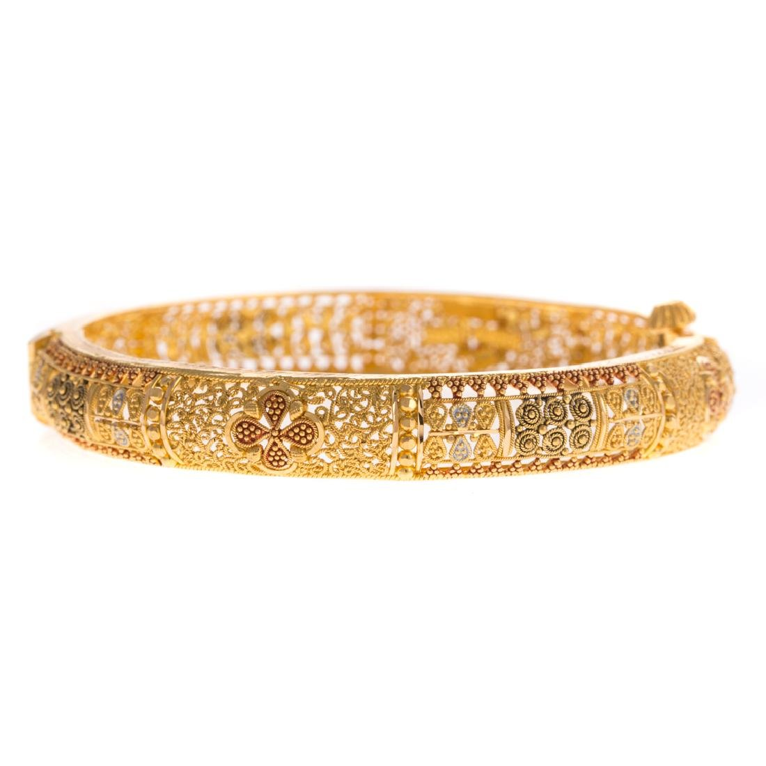 A Lady's 22K Hinged Bangle Bracelet