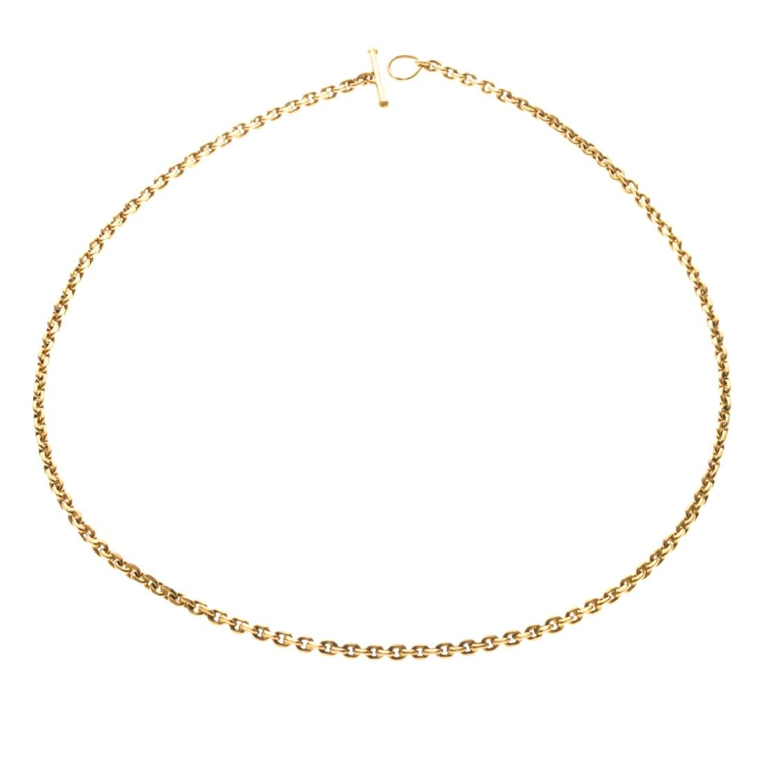 A Curbed Link Necklace in 22K Gold