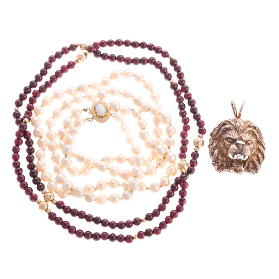 A Collection of Beads and Lion Pendant