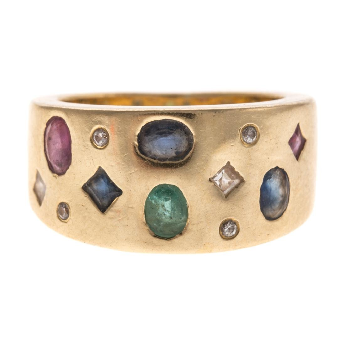 A Lady's 18K Multi Stone Wide Band