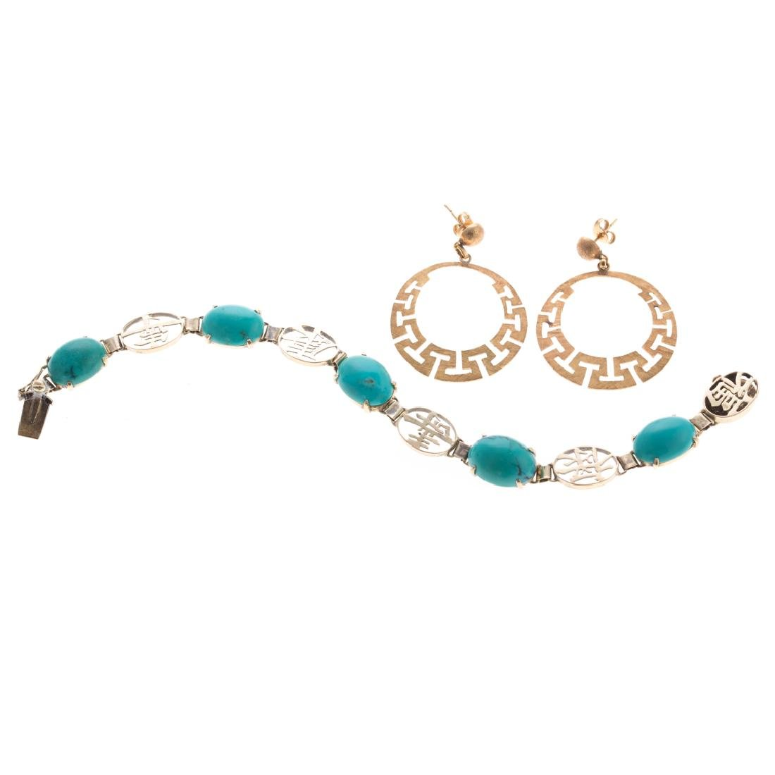 A Pair of Earrings with Turquoise Bracelet in Gold