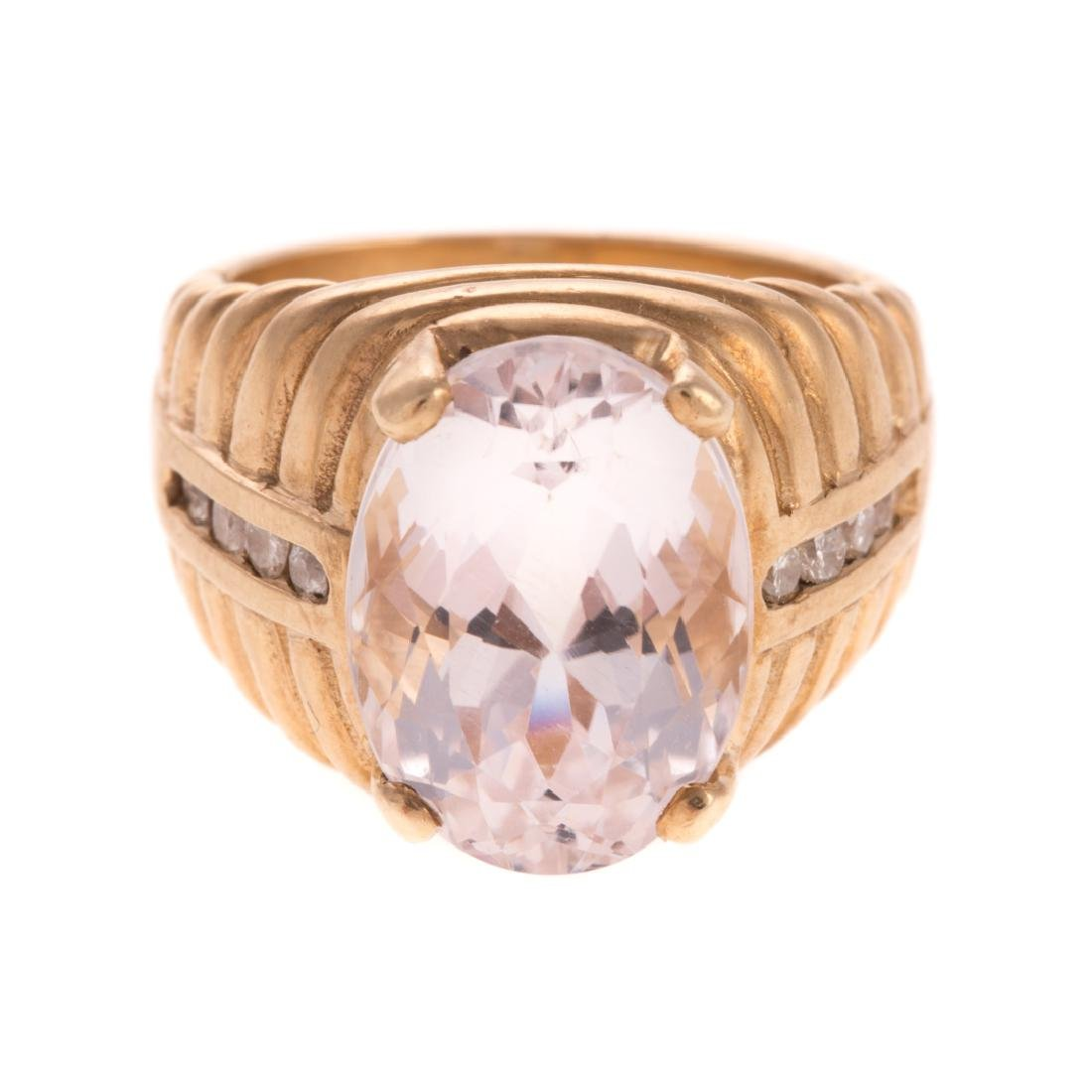 A Lady's Kunzite and Diamond Ring in 14K
