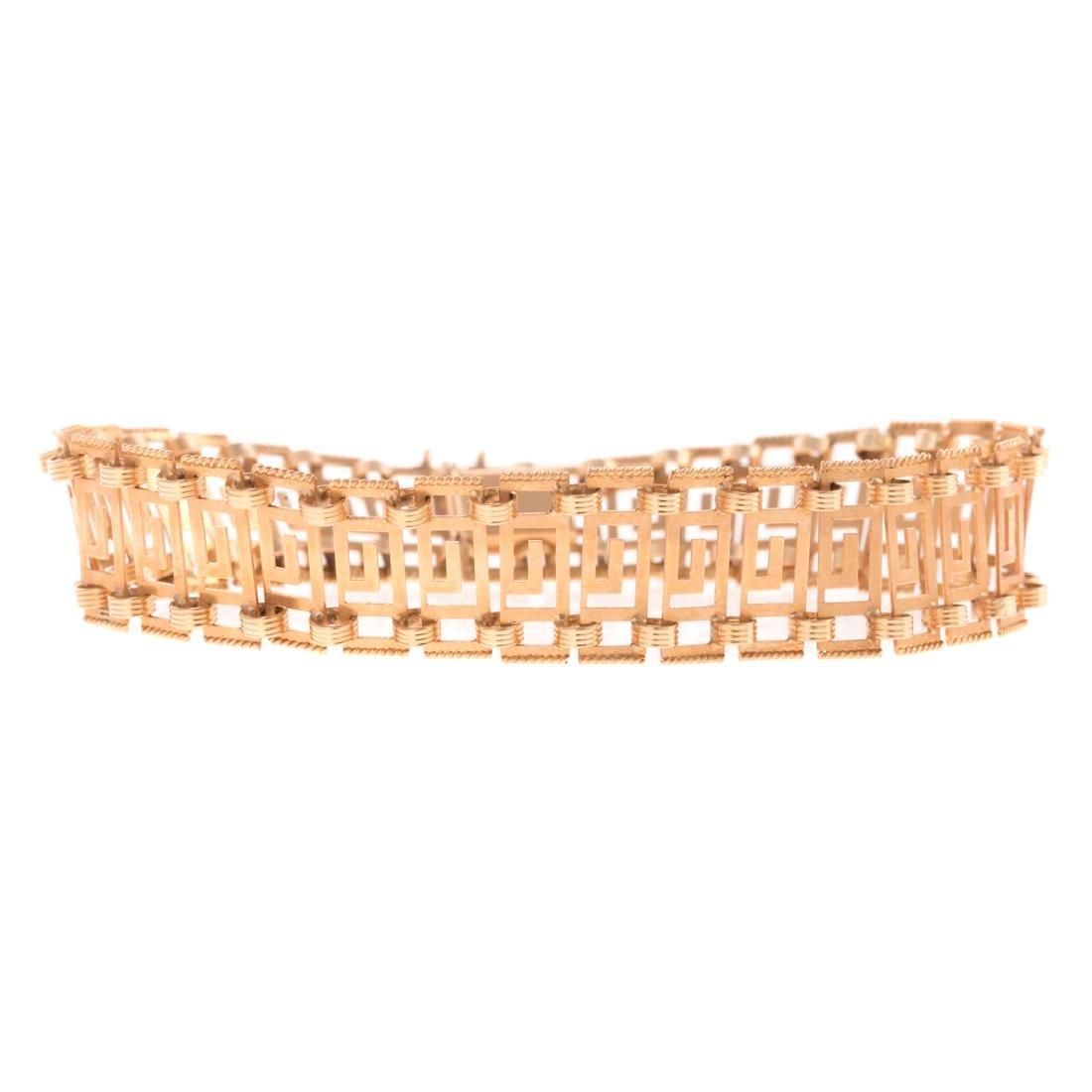 A Lady's Greek Key Designed Bracelet in 18K