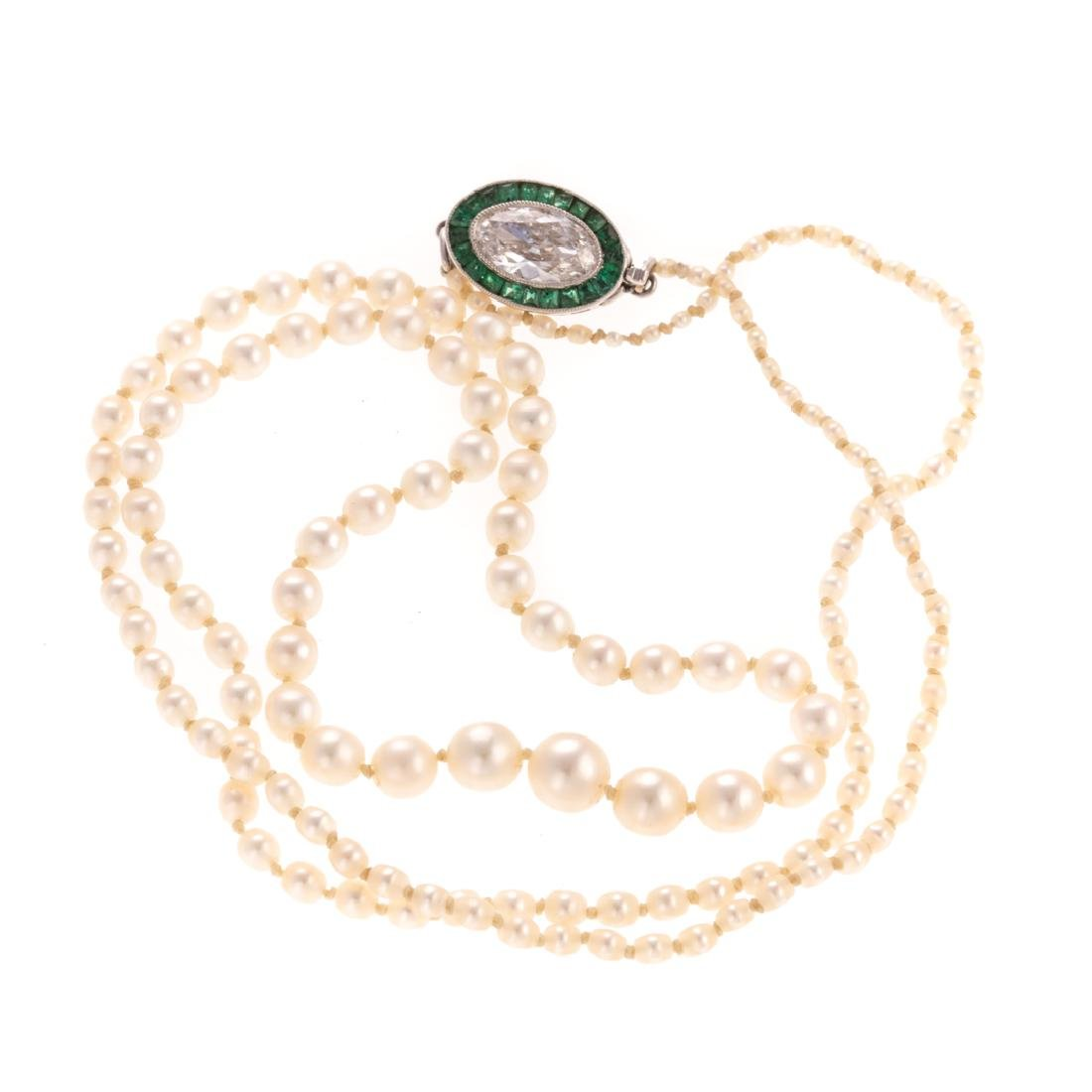 An Art Deco Diamond & Emerald Closure on Pearls