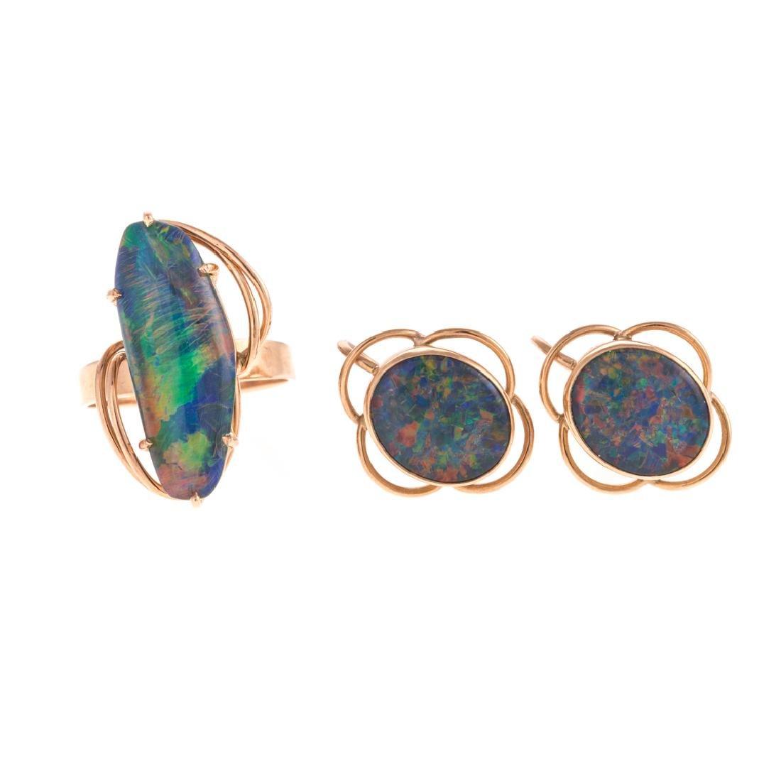A Lady's Opal Ring & Matching Earrings in 9K