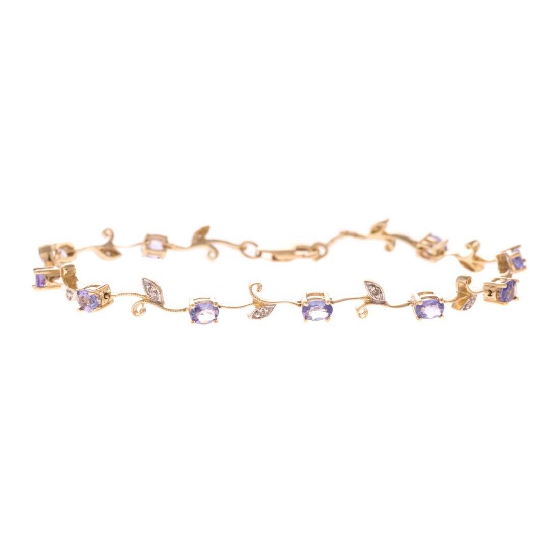 A Lady's Tanzanite & Diamond Floral Bracelet