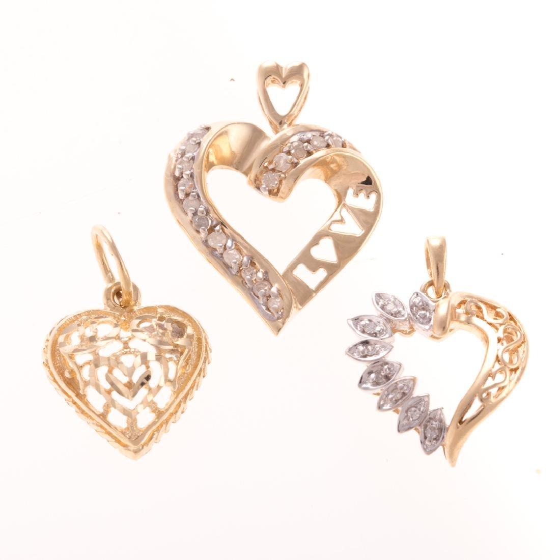 A Trio of Diamond Open Heart Pendants in Gold