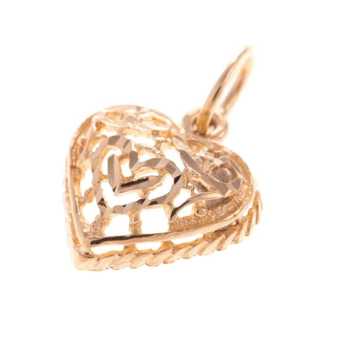A Trio of Diamond Open Heart Pendants in Gold - 4