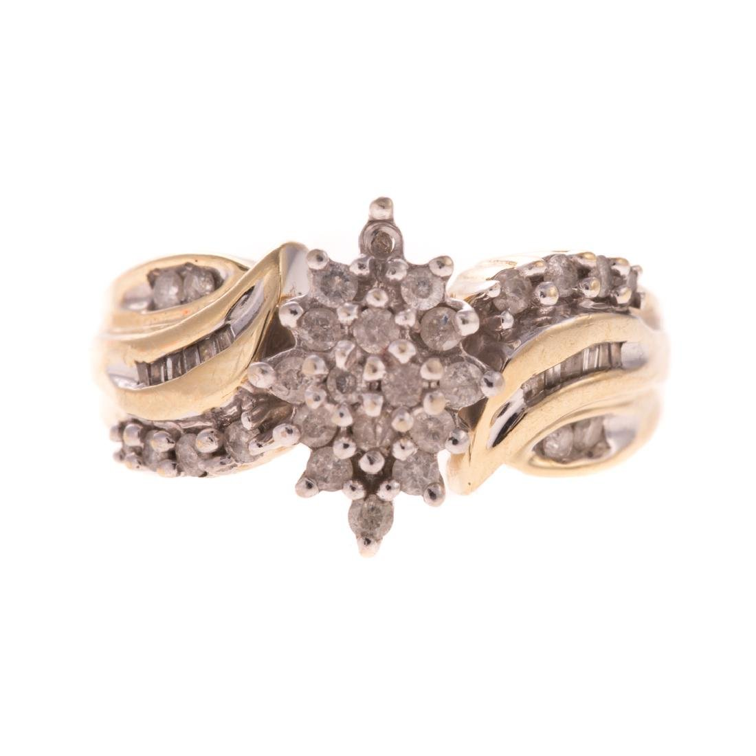 A Lady's 10K Diamond Cluster Ring