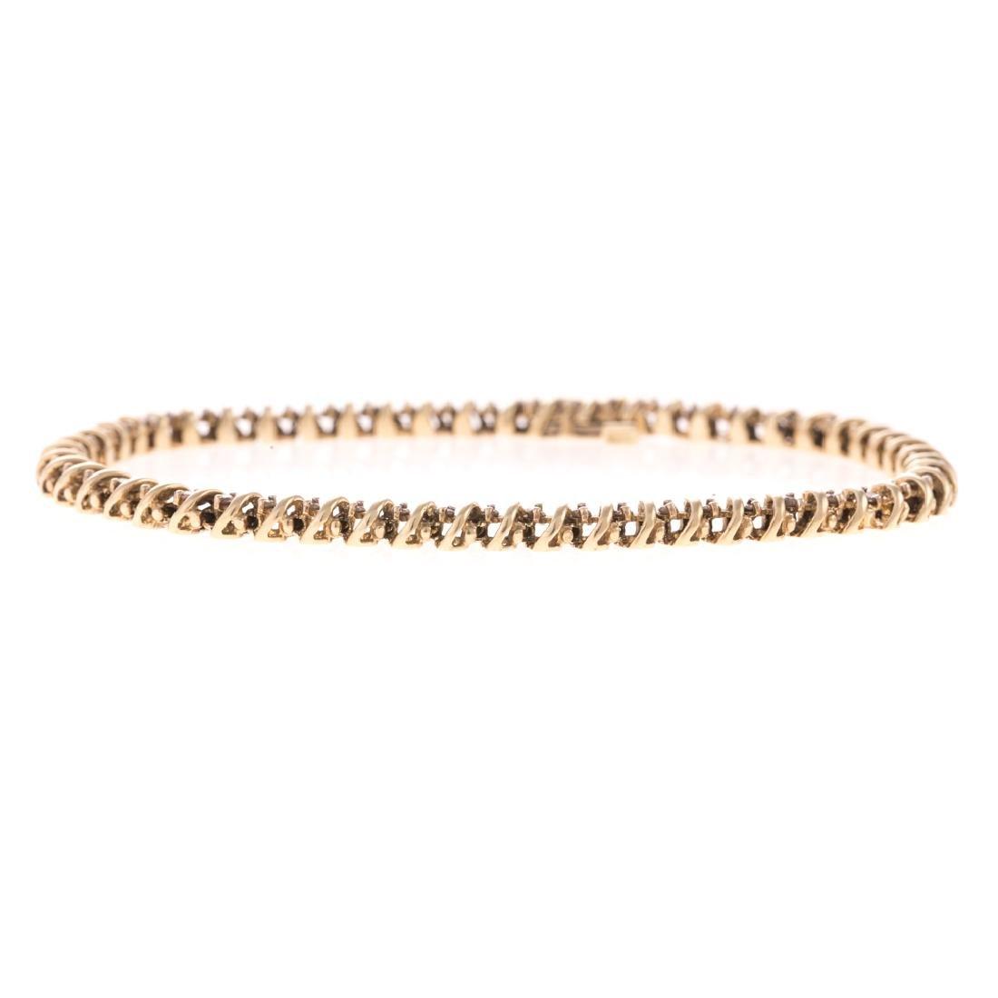 """A Lady's """"S"""" Link Diamond Bracelet in Gold"""