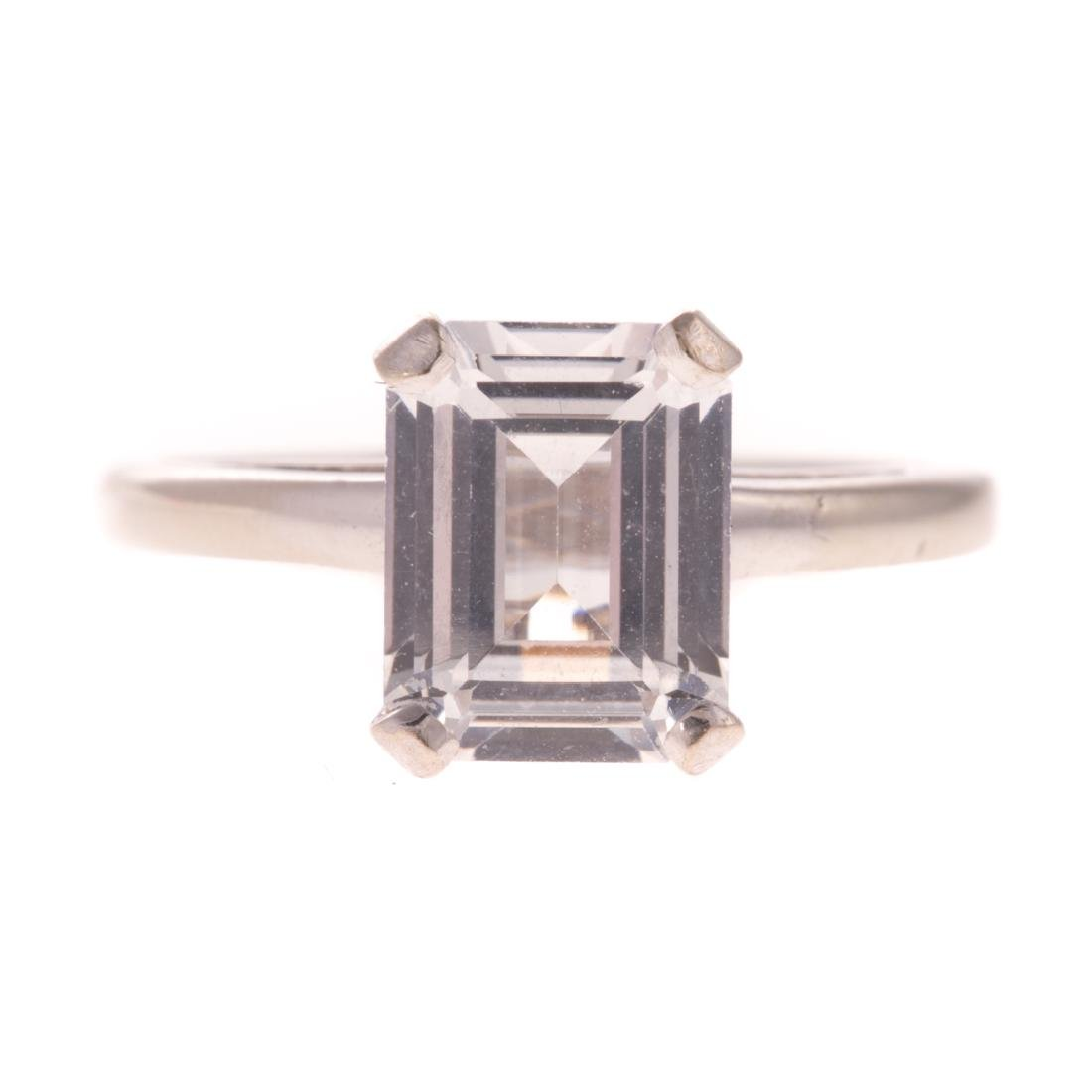 A Lady's 14K Emerald Cut White Sapphire Ring