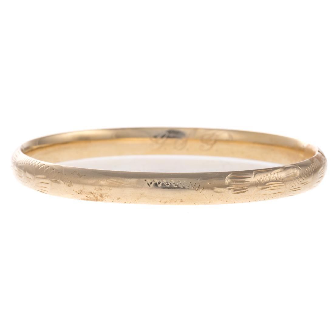 A Lady's Bangle Bracelet in 14K Gold