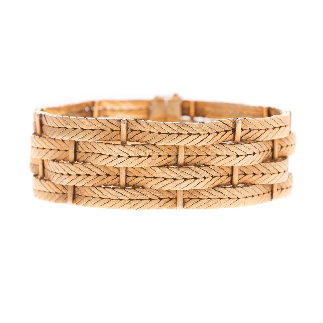 A Lady's Buccellati 4 Row Woven Bracelet in 18K